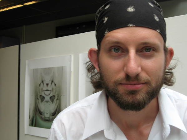 Nathan Selikoff in front of his artwork
